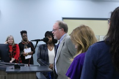 Dr. Granger Babcock speaks at the School Board Meeting.
